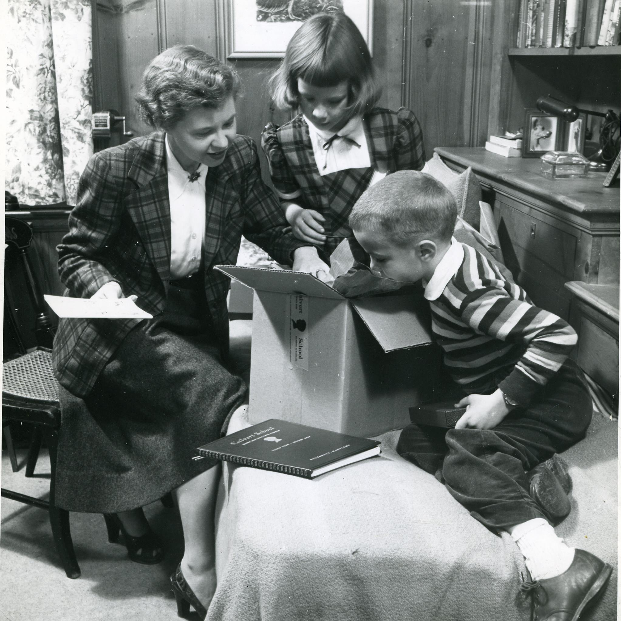 "This photo of Mrs. ""Nippy"" Eason and two of her children became a well-known image used in Calvert's advertisements for home learning. These advertisements were used in print publications such as McCalls magazine and National Geographic."