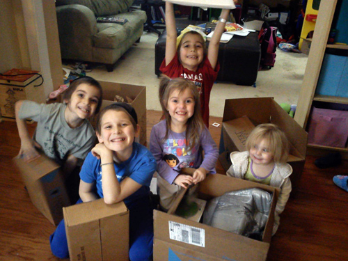 Students unboxing their Calvert homeschool curriculum