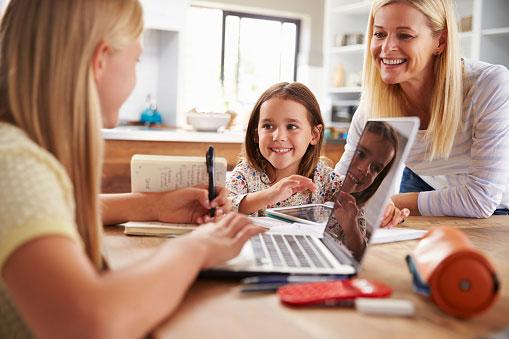 Mother homeschooling siblings