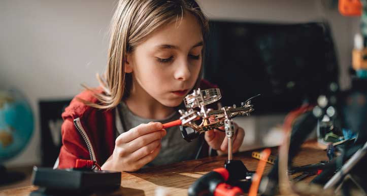 Pre-teen working on computer components